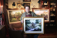 "Monte Sereno resident and artist Thomas Kinkade holds an oil painting of a home on Shannon Road that he completed recently for a Los Gatos homeowner. The artist will auction off his talents at the Oct. 17 ""Tatste of Los Gatos"" fundraiser, with the highest bidder getting his or her home or landmark building painted by Kinkade. Flanking Kinkade are oil paitings of Los Gatos High School and N. Santa Cruz Avenue that will be donated to the Los Gatos-Monte Sereno Police Department. Prints of these paintings will be sold at the fundraiser, which benefits the police department.  (George Sakkestad/Los Gatos Weekly Times)"