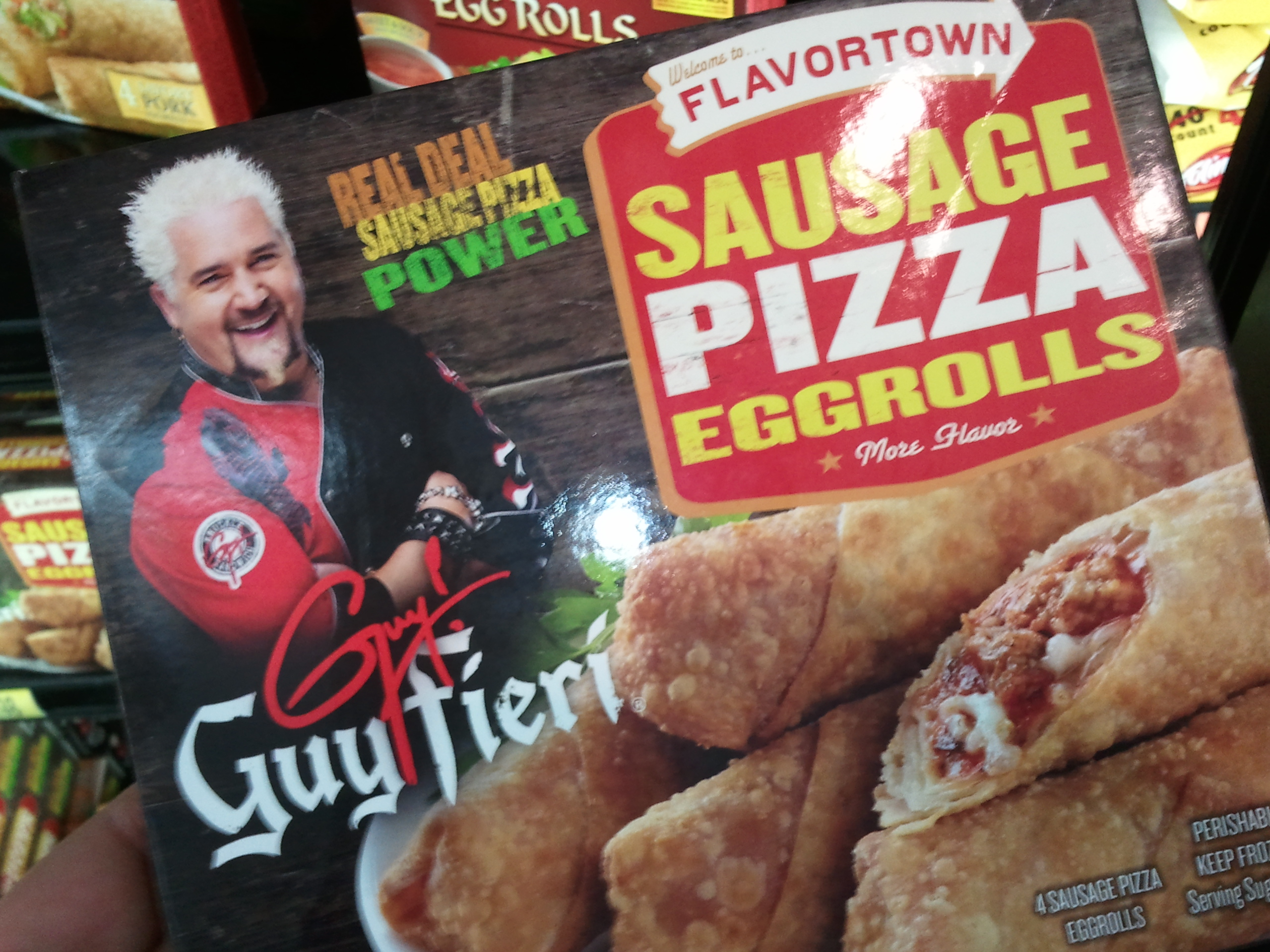 Guy Fieri, proud sponsor of Flavortown sausage pizza eggrolls