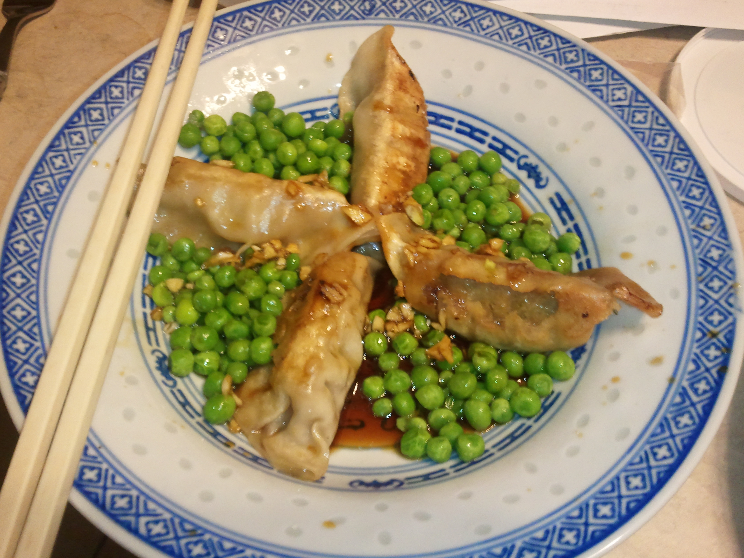 Chinese dumplings on a bed of peas